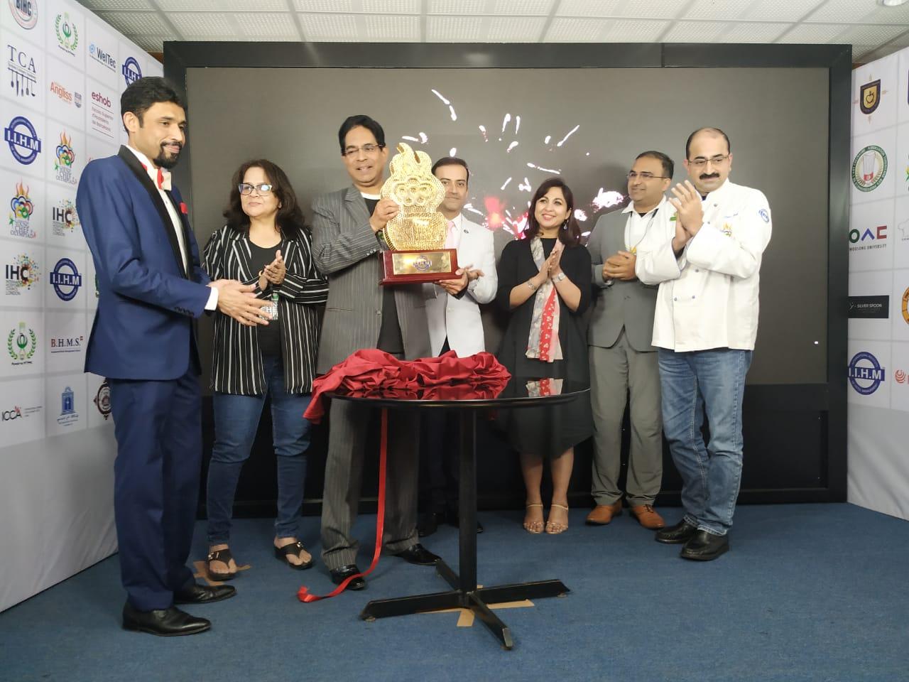 Suborno Bose, chairman, YCO Global Council and IIHM campus directors with the YCO Trophy. Image Source: IIHM