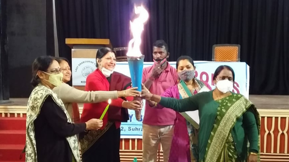 Siuli Sarkar, the principal, and professors came together to light the torch. Image source: Lady Brabourne College