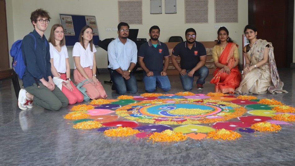 Students try their hands on rangoli. Image Source : Sister Nivedita University