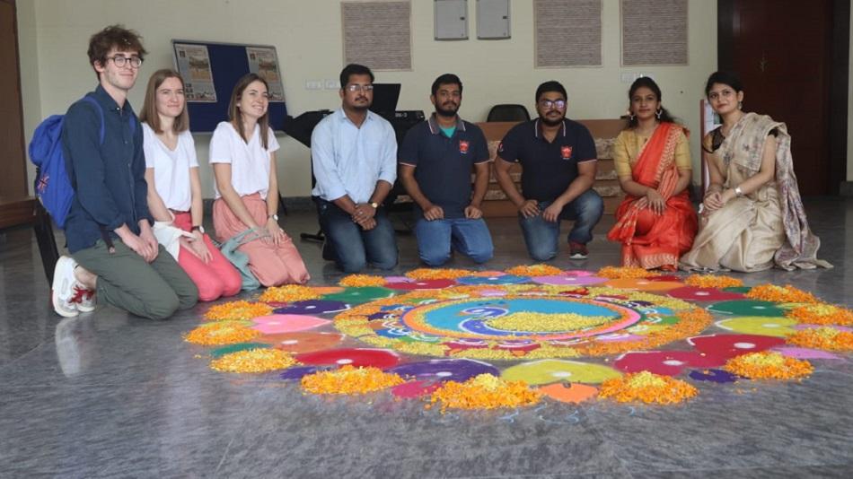 Students try their hands on rangoli. Image Source : Sister Nivedita University