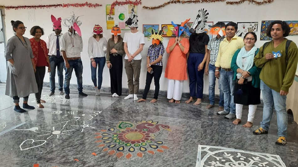 Workshop on traditional mask making. Image Source : Sister Nivedita University