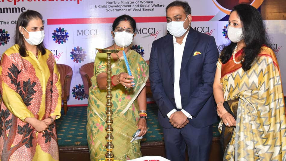 """Minister of women and child development and social welfare, government of West Bengal  lighting the lamp in the event """"Grassroots Entrepreneurship Mentorship Programme Convocation of the 1st Cohort"""". Image Source: MCCI"""