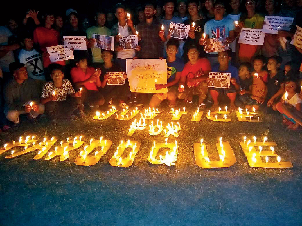 Dark times: A candle-light vigil in remembrance of Farooque Khan