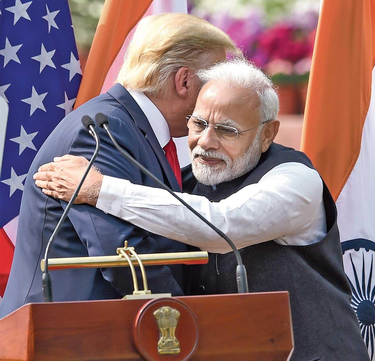 Donald Trump and Narendra Modi hug each other in New Delhi.