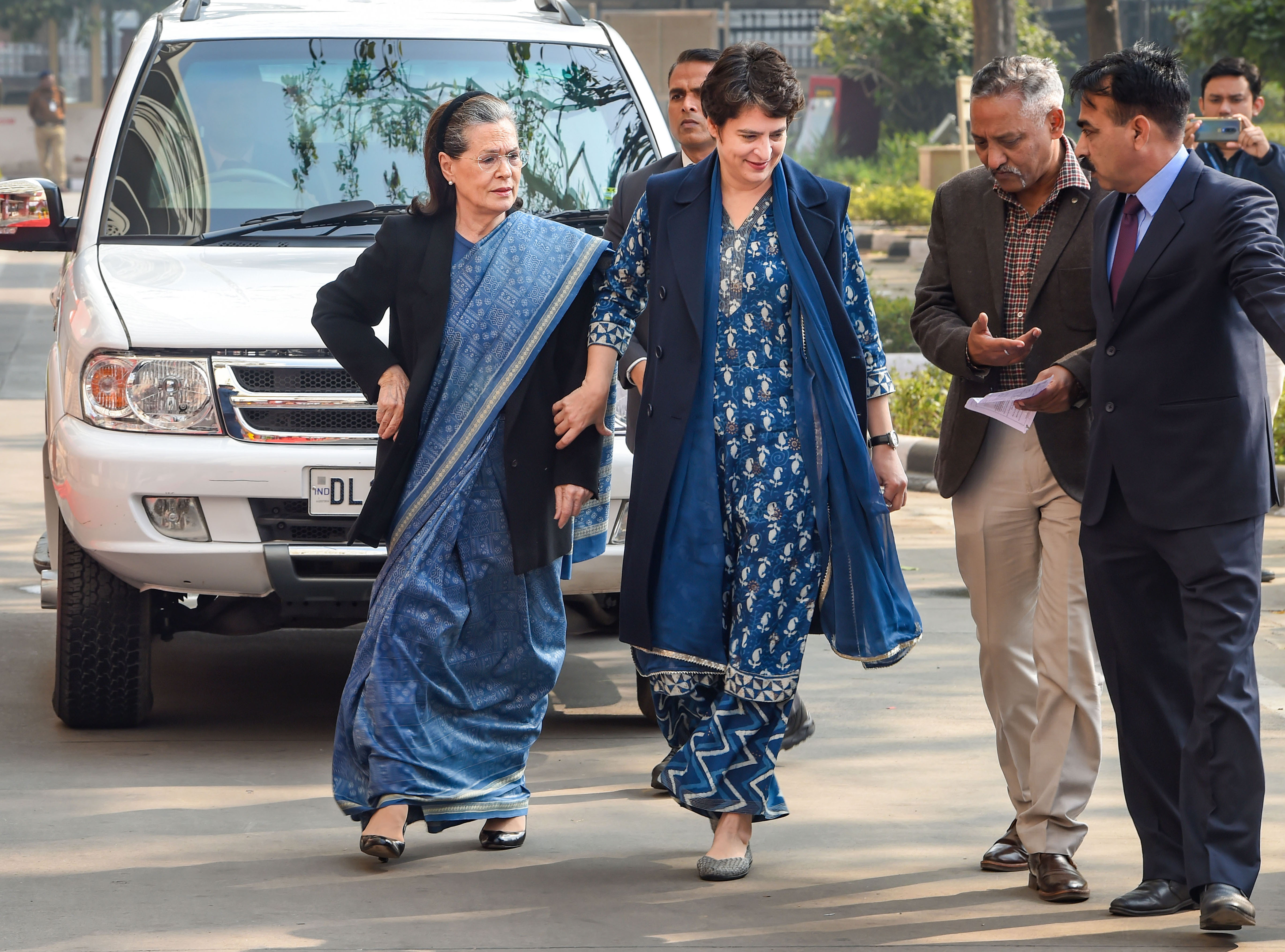 Congress president Sonia Gandhi, along with party's general secretary Priyanka Gandhi Vadra, arrives at Nirman Bhawan polling station to cast her vote during the Delhi Assembly elections, in New Delhi, Saturday, February 8, 2020
