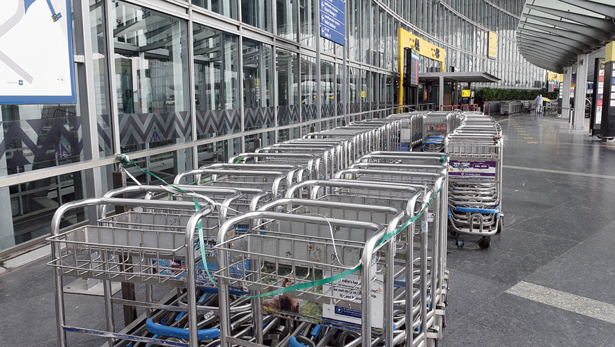 Lines of locked trolleys outside the airport terminal, at the departure level, on Thursday