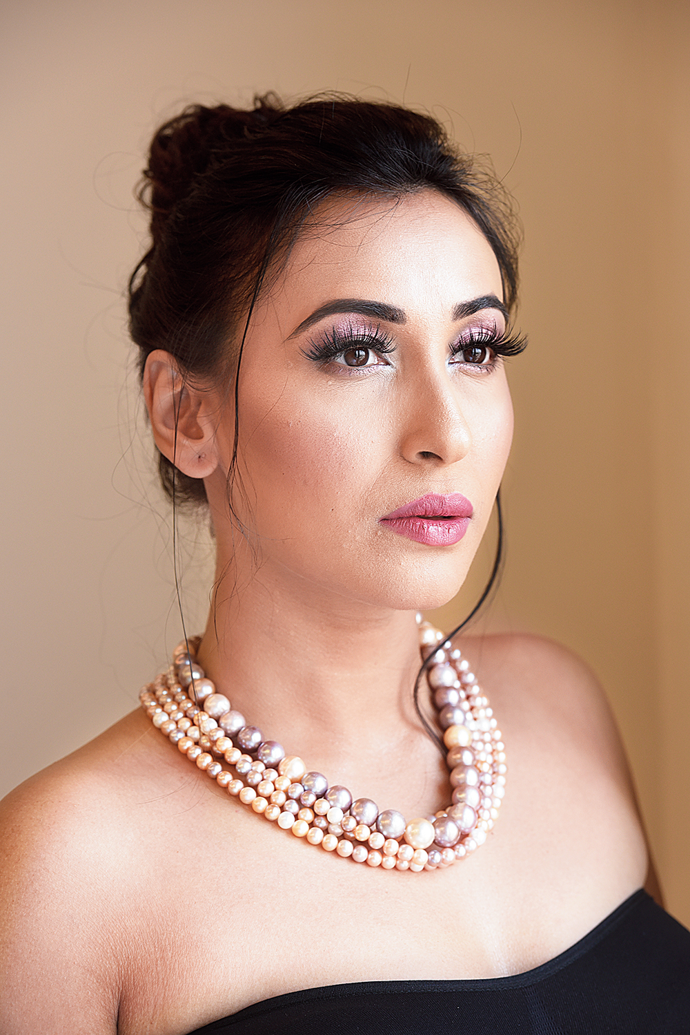 "Coco Chanel had once said: ""A woman needs ropes and ropes of pearls."" This look with four strings of multicoloured large and small South Sea pearls in shades of pink, peach, ivory and cream makes Sayani look like a diva."