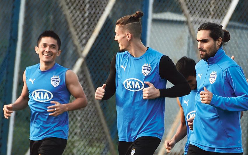 Bengaluru FC captain Sunil Chhetri (left) with teammates during a training session at the Salt Lake Stadium practice ground on Tuesday
