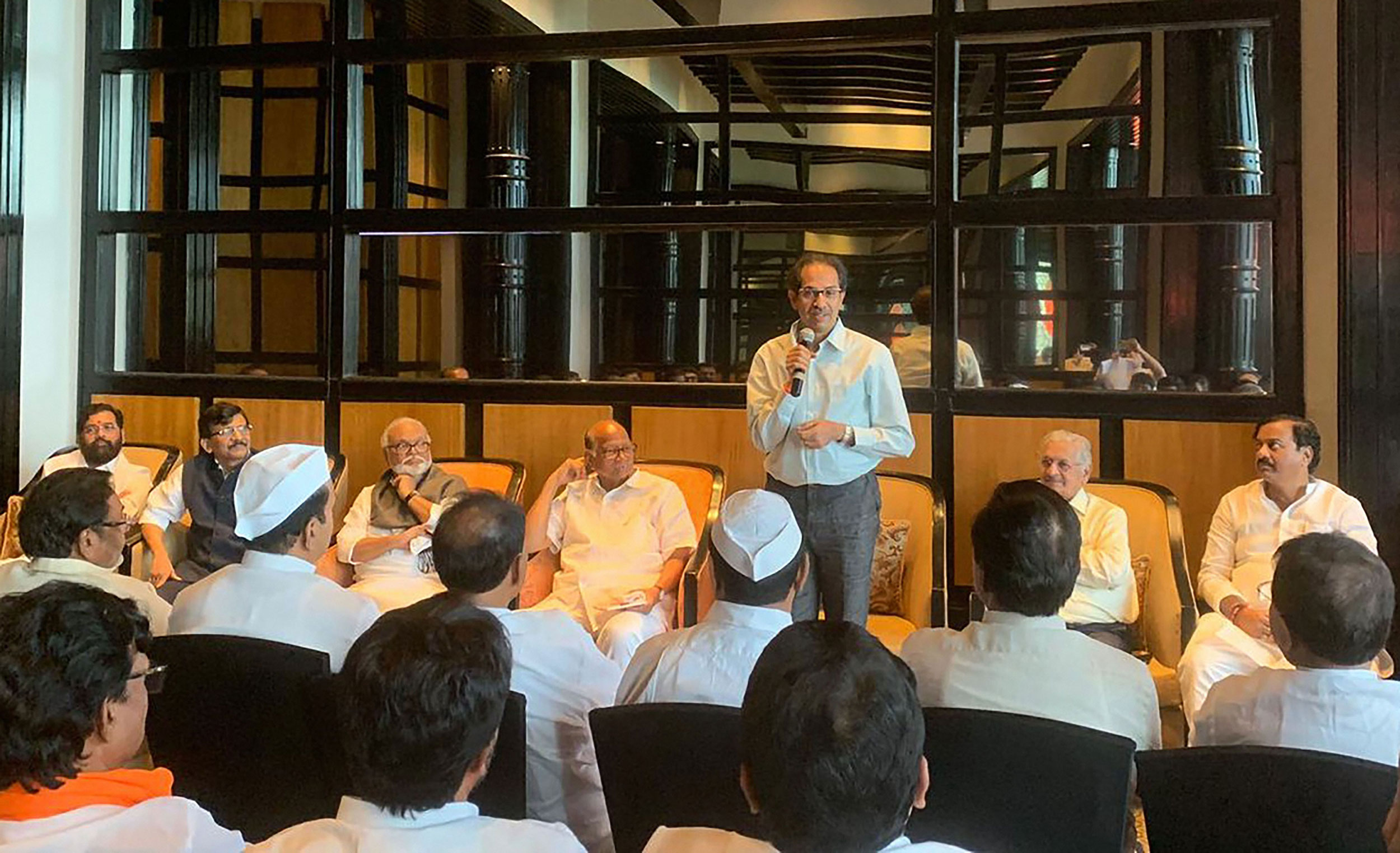 NCP party meeting, chaired by Sharad Pawar, underway at Hotel Renaissance, Mumbai, on Sunday. Shiv Sena Chief Uddhav Thackeray and Sanjay Raut were also present. In the video, MLA Jitendra Awhad and NCP workers are seen asking the policemen what business they have at the hotel in Powai.