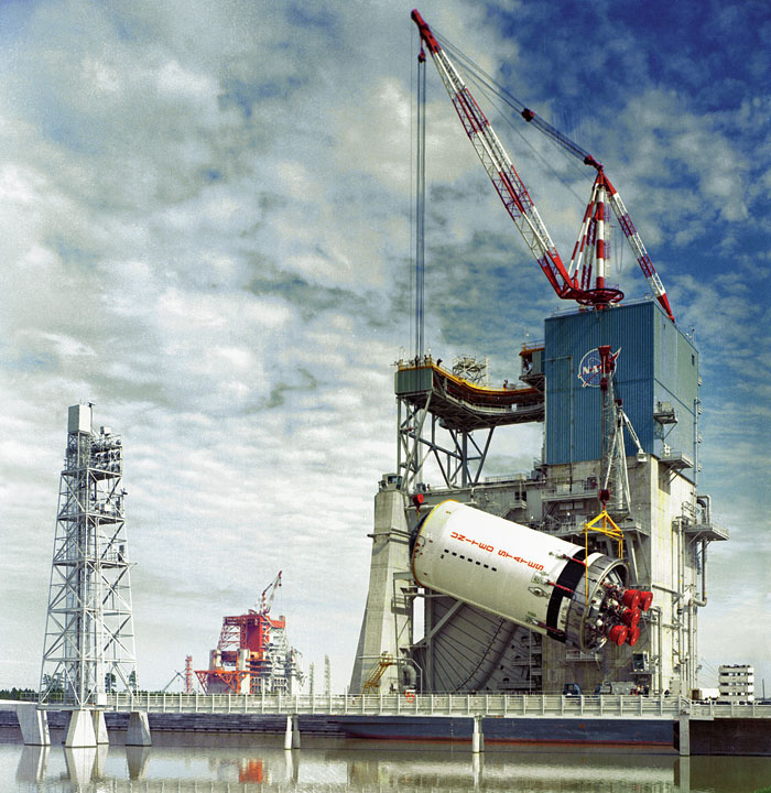 A stage of the Saturn V rocket being hoisted onto a test stand in 1967 at what is now the John C. Stennis Space Center