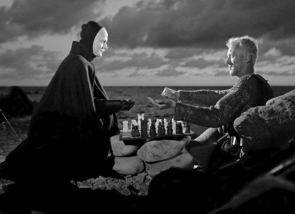 A still from The Seventh Seal (1957), where the knight, played by Max von Sydow, challenges Death to a game of chess