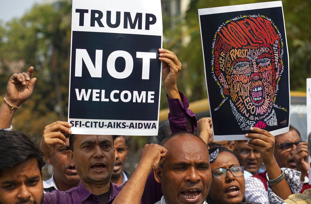 Indian activists shout slogans against U.S. President Donald Trump during his India visit, in Gauhati, on Monday. Indian Prime Minister Narendra Modi's Hindu nationalist government is pulling out all the stops, at an expense of more than $14 million, to woo the president and first lady Melania Trump. But experts have said that very little of substance will be achieved for either side beyond the pageantry and symbolism.