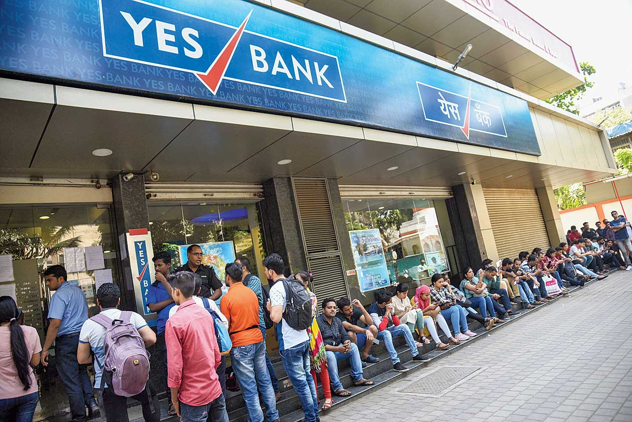 Account holders queue up outside Yes Bank to withdraw money in Mumbai on Saturday.