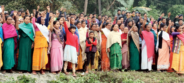 Villagers wait in Tamulpur.