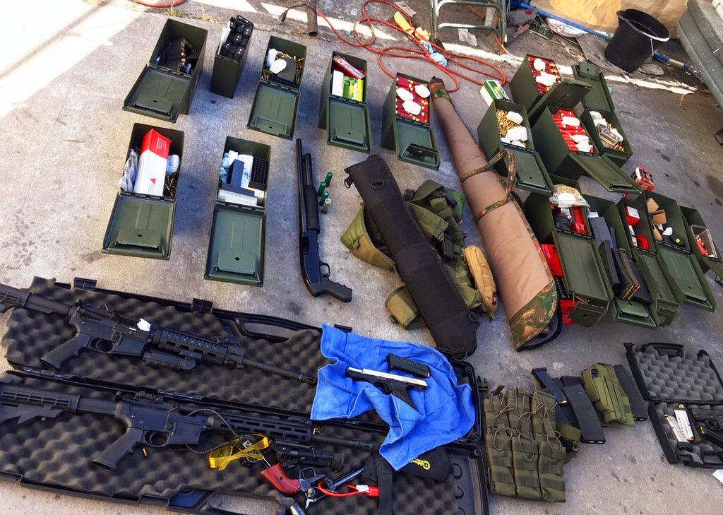 This undated file photo released by the Long Beach, California, police shows weapons and ammunition seized from a cook at a Los Angeles-area Marriott who allegedly threatened a mass shooting. Rodolfo Montoya was arrested on August 20, after allegedly telling a co-worker he planned to shoot people