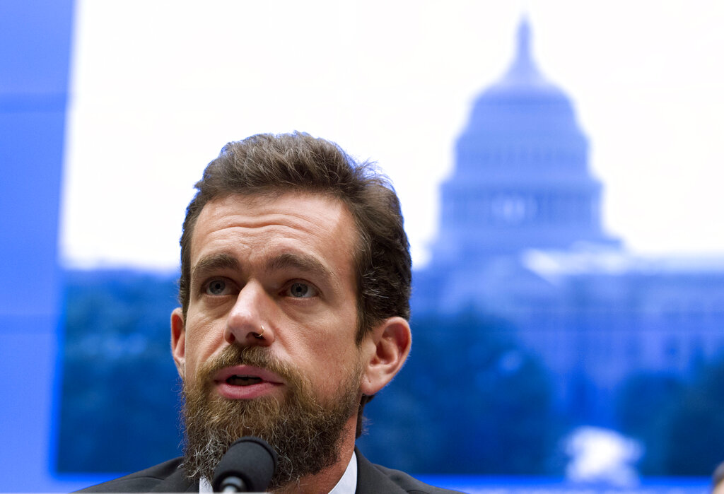 In this September 5, 2018, file photo Twitter CEO Jack Dorsey testifies before the House Energy and Commerce Committee in Washington. Dorsey on Wednesday, October 30, 2019, in a series of tweets announced Twitter's new policy of banning all political advertising from its service