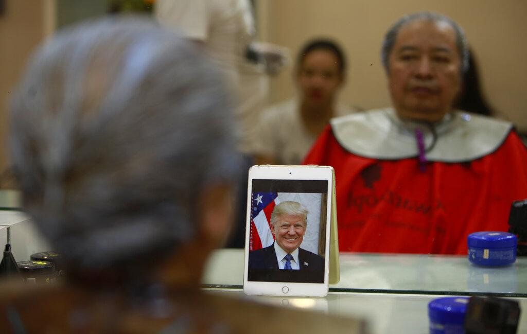 Le Phuc Hai, 66, receives a Trump haircut in Hanoi on Tuesday.