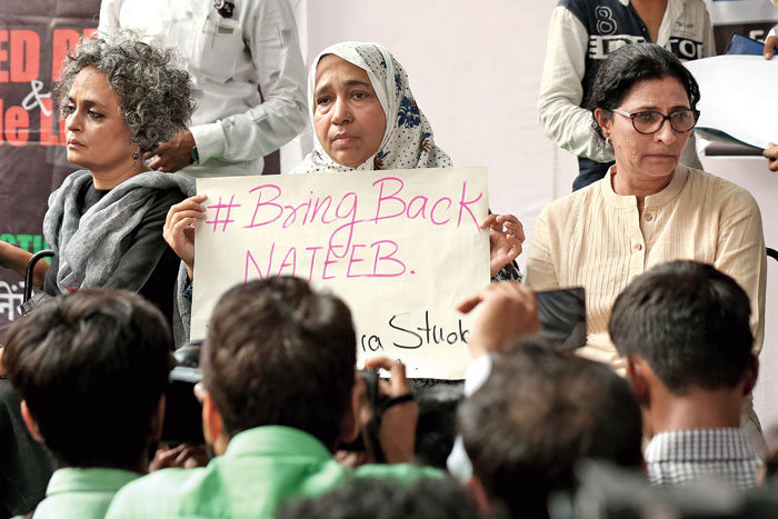 Fatima Nafis (centre), mother of Najeeb Ahmad, with Arundhati Roy and other protesters in New Delhi on Tuesday