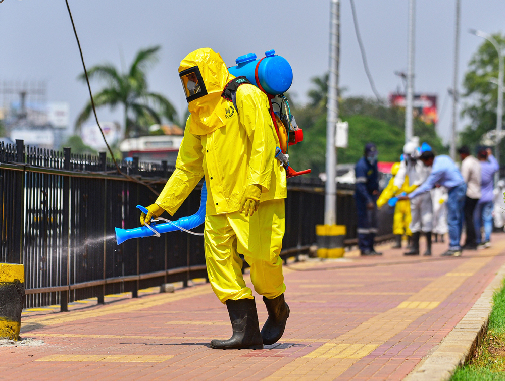 Disaster Response Force worker sprays disinfectant as a precaution against a coronavirus outbreak at public places, in Hyderabad, Friday, March 20, 2020.