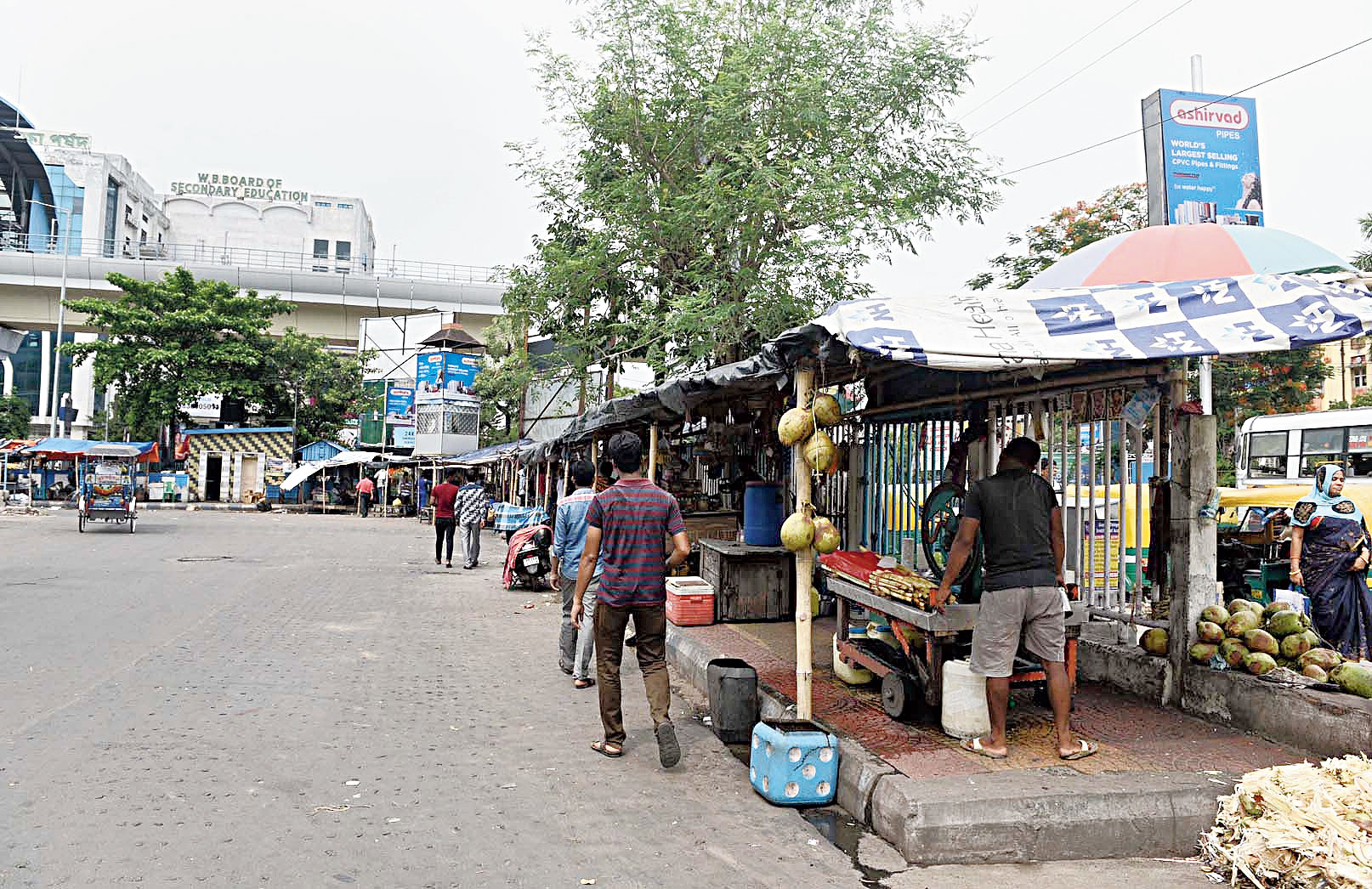 Hawkers' stalls on a footpath inside Karunamoyee bus terminus in Salt Lake on Thursday.
