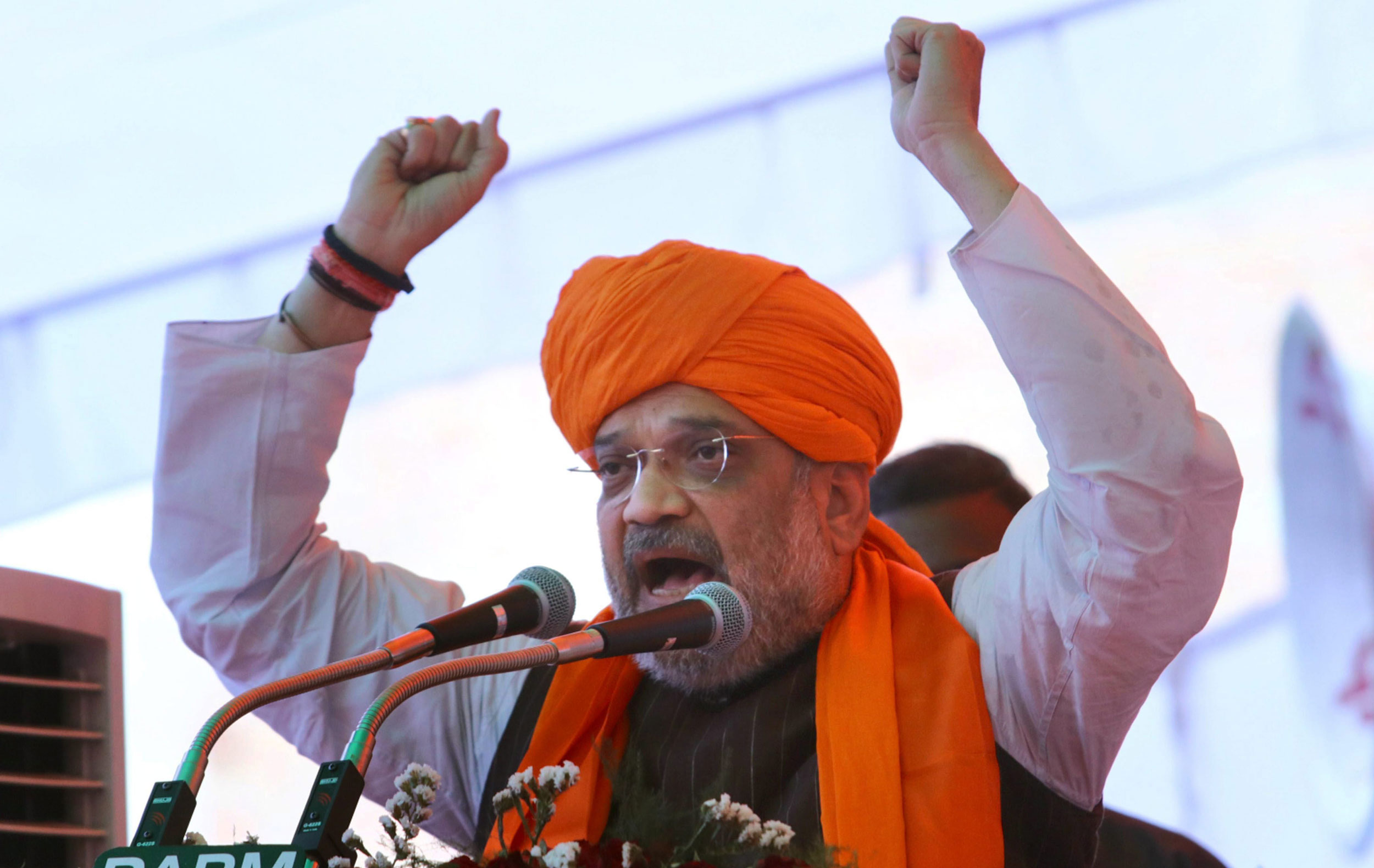 Amit Shah stood atop a decorated truck along with BJP's north and south Calcutta's candidates Rahul Sinha and Chandra Kumar Bose respectively.