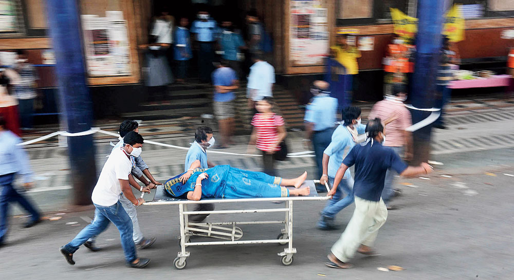 A patient being taken out of the hospital building on Wednesday
