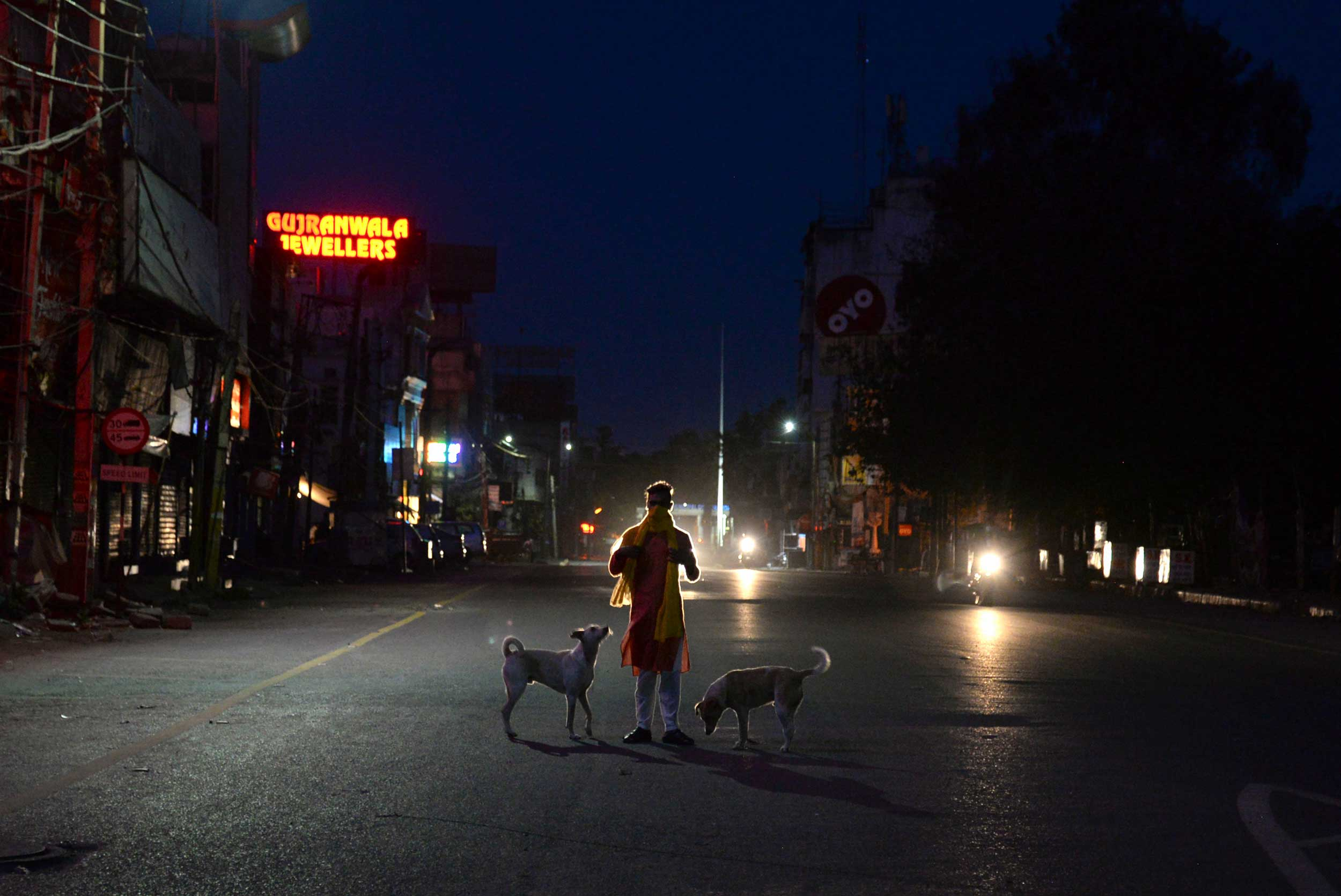 A man walks on a deserted road during in Jalandhar on Saturday.