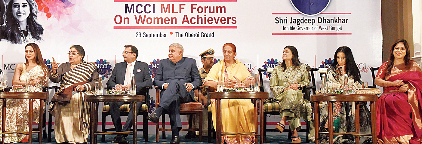 (From left) Mimi Chakraborty, Usha Uthup, Vishal Jhajharia, president of Merchants' Chamber of Commerce & Industry; Jagdeep Dhankhar; Sudesh Dhankhar, the governor's wife; Prapti Jhajharia, chairperson of MCCI ladies' forum;  Anamika Khanna and Chaitali Das, social entrepreneur.