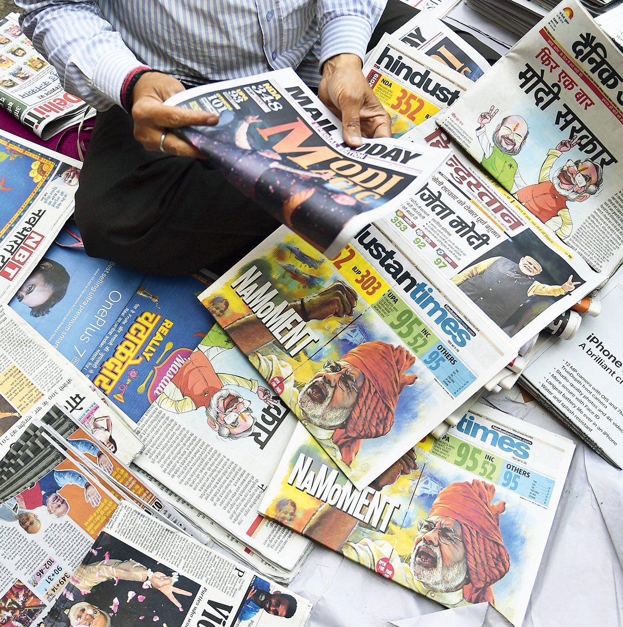 Indian newpapers  featuring  Modi's victory.