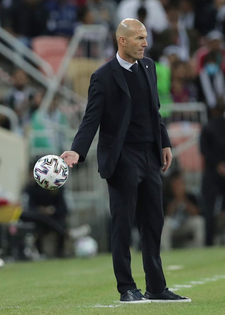 Real Madrid's head coach Zinedine Zidane looks on his team during the Spanish Super Cup Final soccer match between Real Madrid and Atletico Madrid