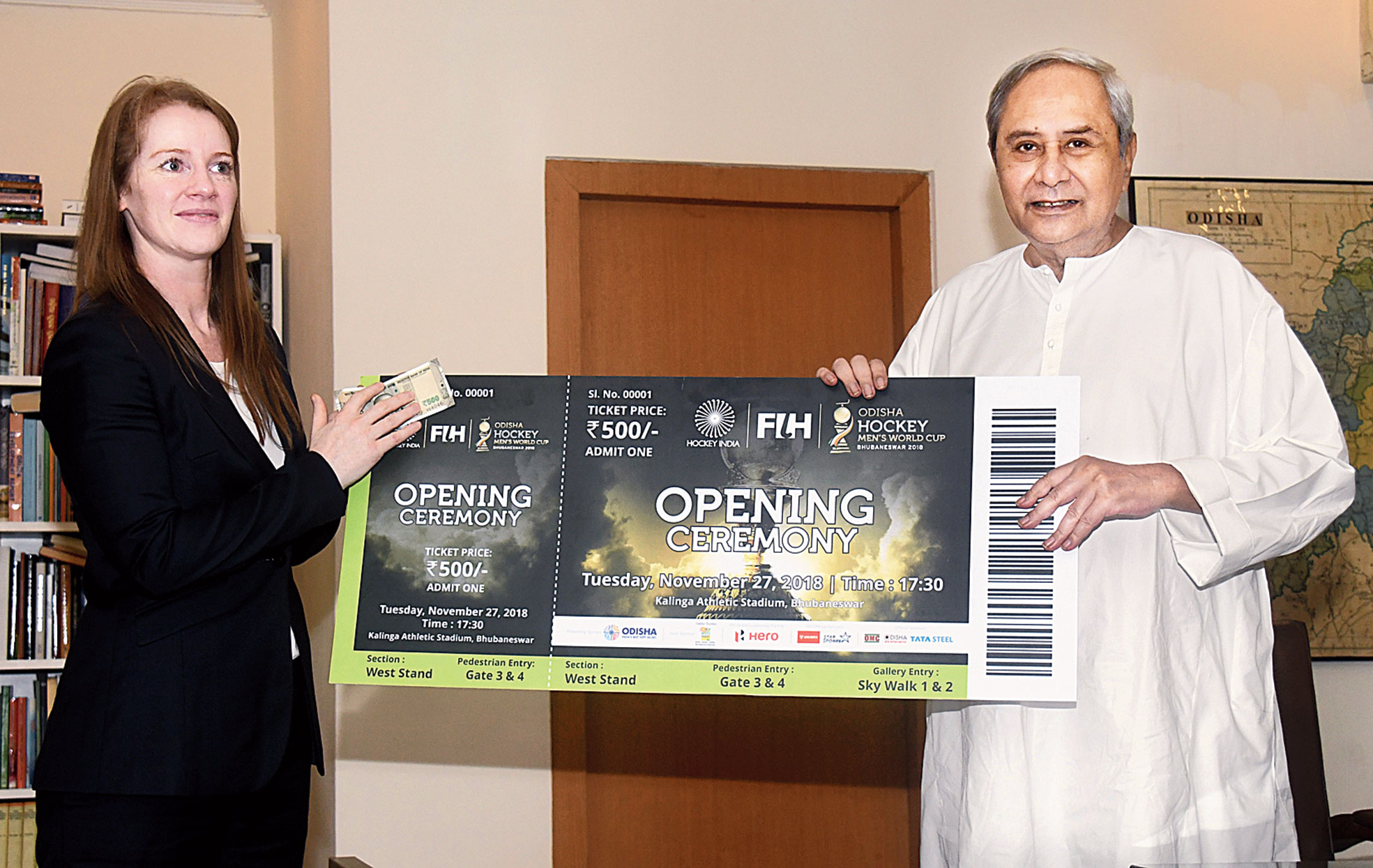 Hockey India CEO Elena Norman presents the first ticket of the Men's Hockey World Cup to chief minister Naveen Patnaik in Bhubaneswar on Monday.