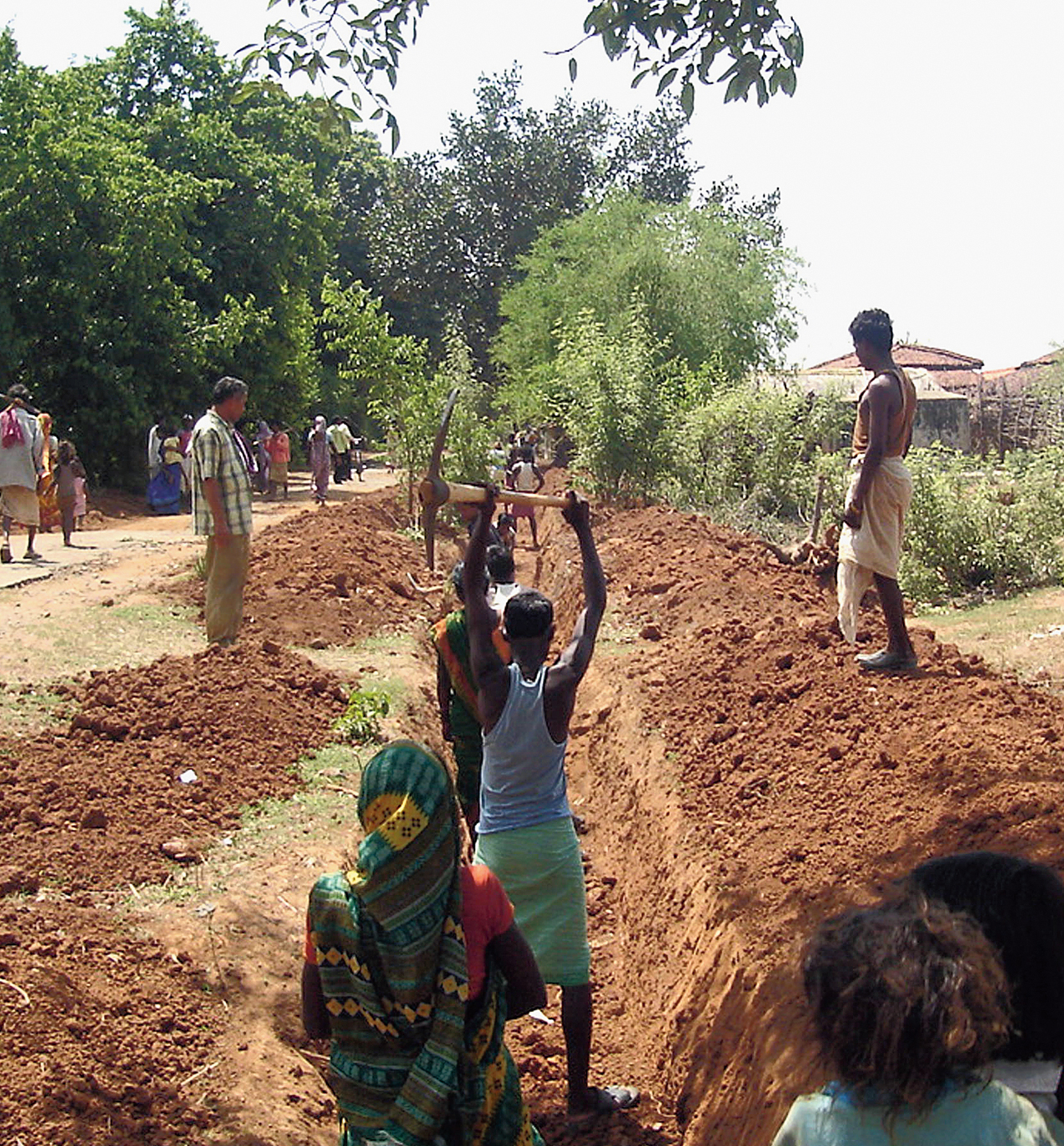 Villagers work on an irrigation canal under MGNREGA at Palma in Dhanbad.