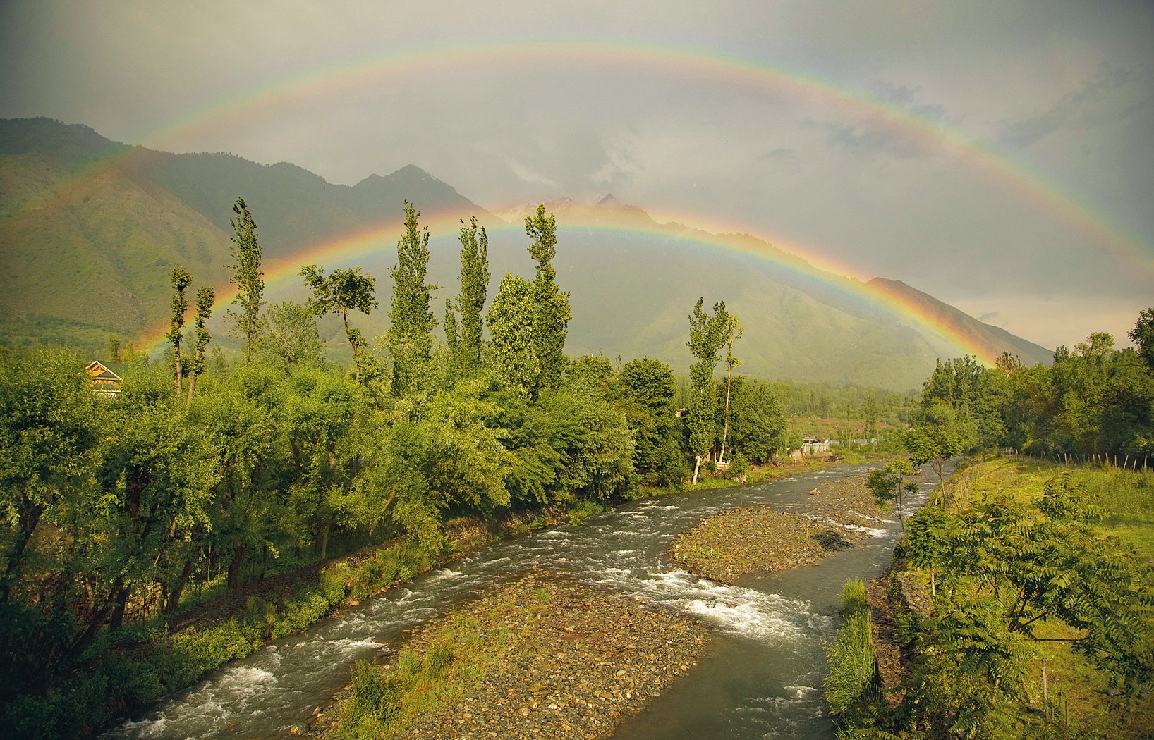 Rainbow on the Zabarwan hills during a brief spell of rain on the outskirts of Srinagar on Monday.