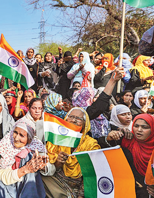 Elderly women wave tricolours during their ongoing protest against CAA and NRC at Shaheen Bagh in New Delhi, Sunday, February 16, 2020
