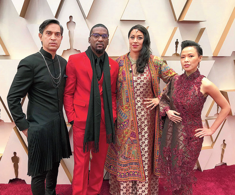 (From left) Sami Khan, the director of St Louis Superman; Bruce Franks Junior, on whom the film is based; co-director Smriti Mundhra and Poh Si Teng, producer, pose on the red carpet at the 92nd Academy Awards in Hollywood on Sunday