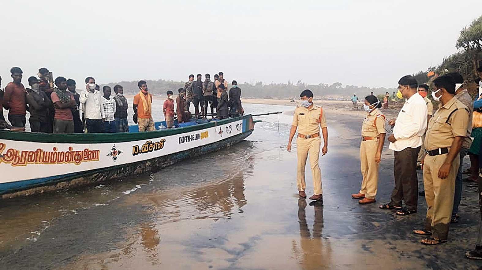 Police take the migrants to the quarantine centre after they reach the Dankuru beach near Ichhapuram in Andhra Pradesh on Monday morning.