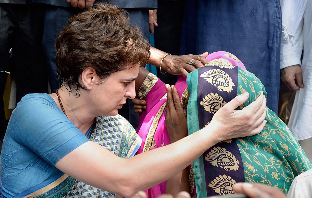 Priyanka Gandhi Vadra consoles a family member of Sonbhadra massacre victim on July 20, 2019. Her spontaneous gesture of compassion is a rare instance of humanity in Indian politics