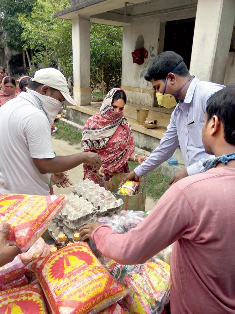 Sanatan Jana distributes food packets in East Midnapore