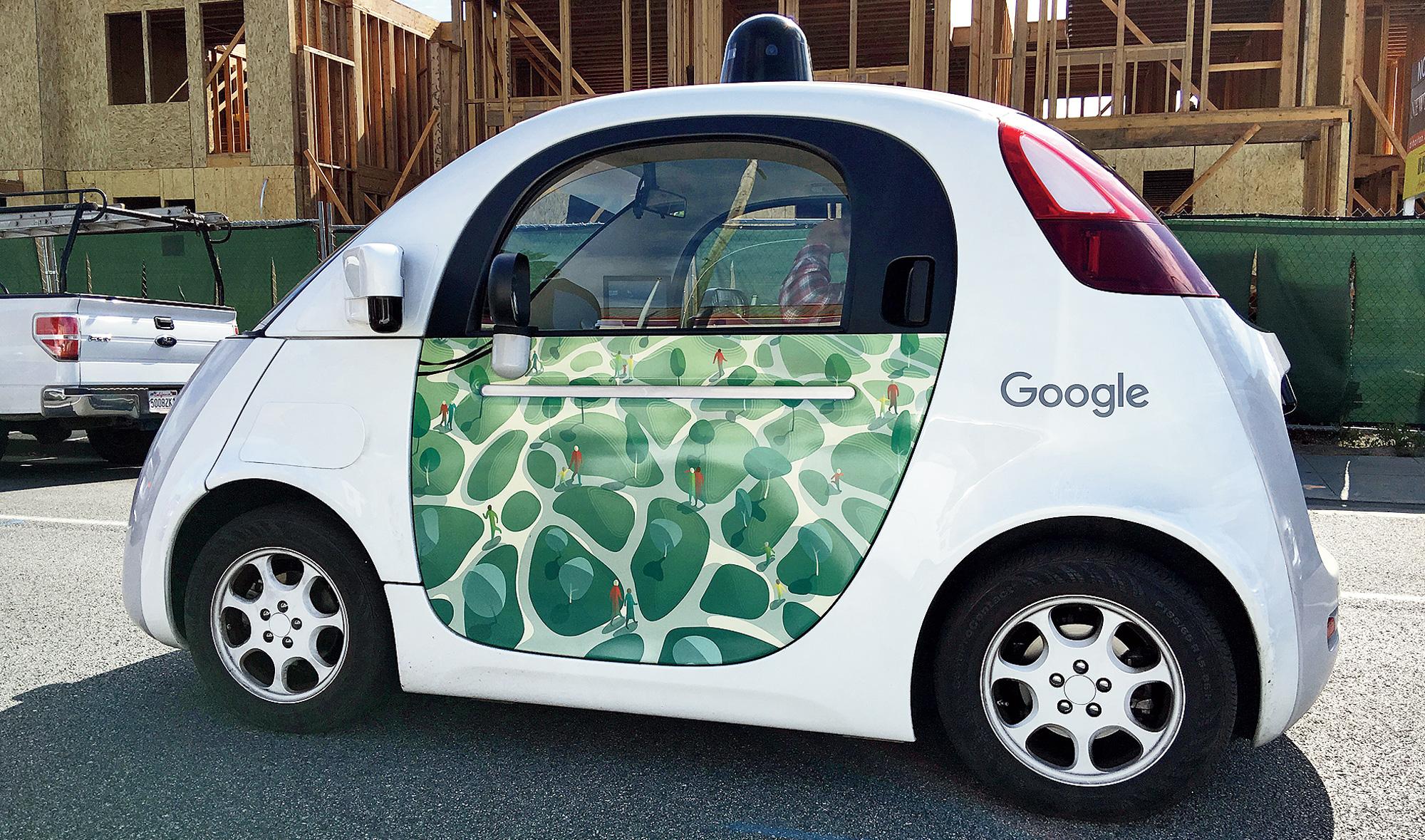 Handsfree: A self-driving car on a suburban street in Mountain View, California, US.