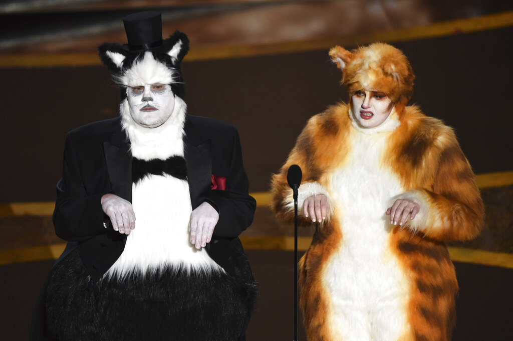 James Corden, left, and Rebel Wilson present the award for best visual effects at the Oscars on Sunday, Feb. 9, 2020, at the Dolby Theatre in Los Angeles