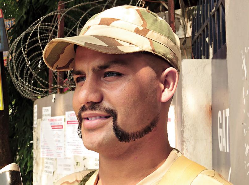 Constable Santosh Rai with an elaborate moustache.