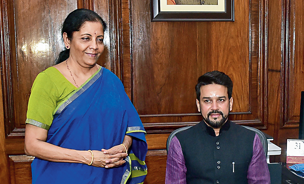 In the presence of Sitharaman, Anurag Singh Thakur takes charge as minister of state, finance and corporate affairs, on Friday.