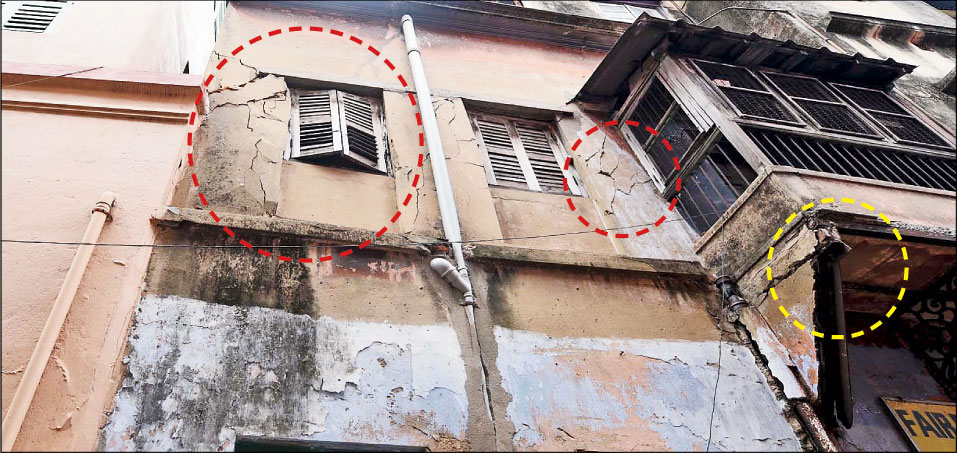 Cracks on a house (circled in red) in Bowbazar that developed while East-West Metro's tunnel-boring work was on. Residents said a portion of a shade (circled in yellow) collapsed.