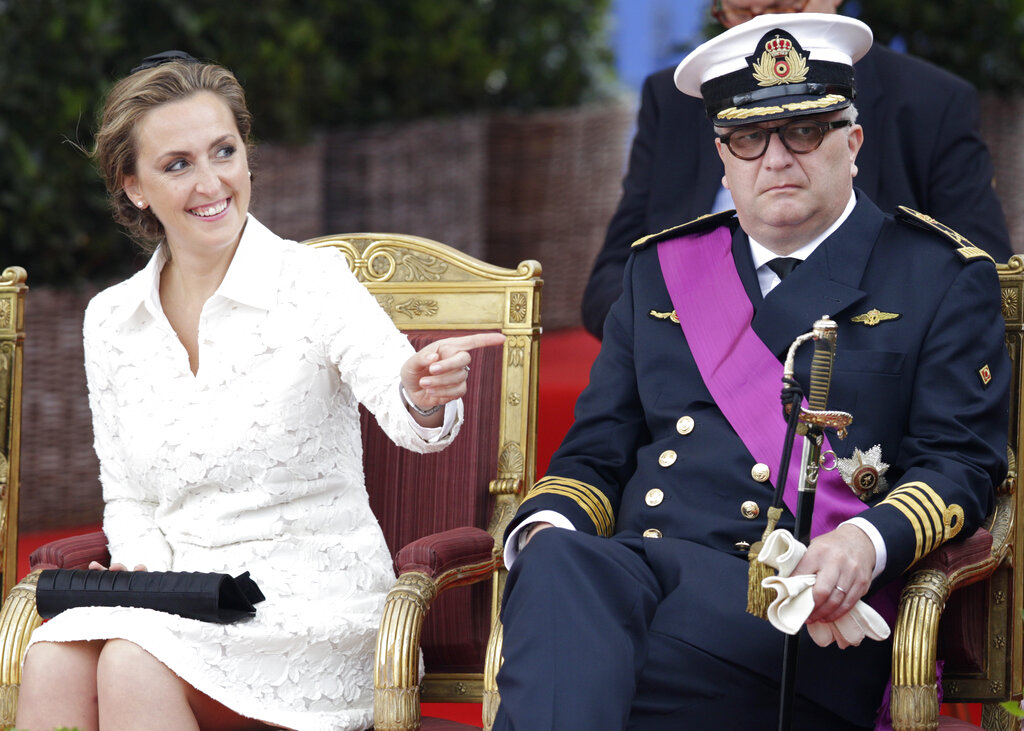 File photo of Belgium's Prince Laurent and his wife Claire watching a military parade on Belgian National Day, in front of the Royal Palace in Brussels