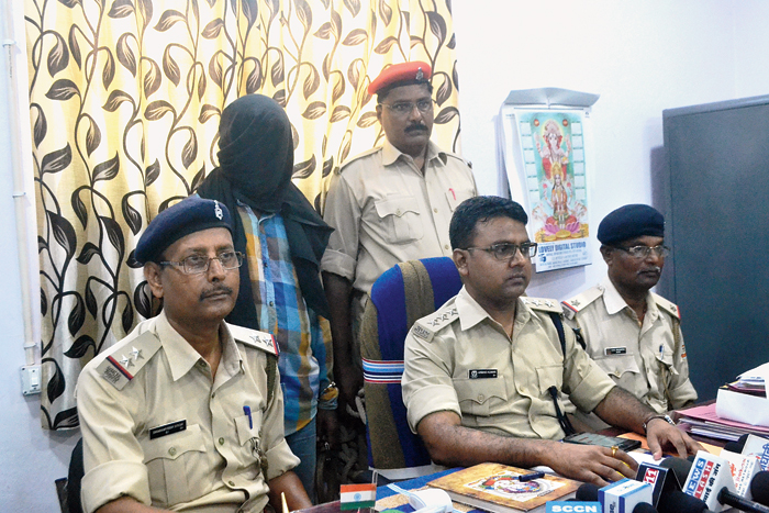 DSP Arvind Kumar (centre) with the rape accused at Sonari police station in Jamshedpur on Friday.