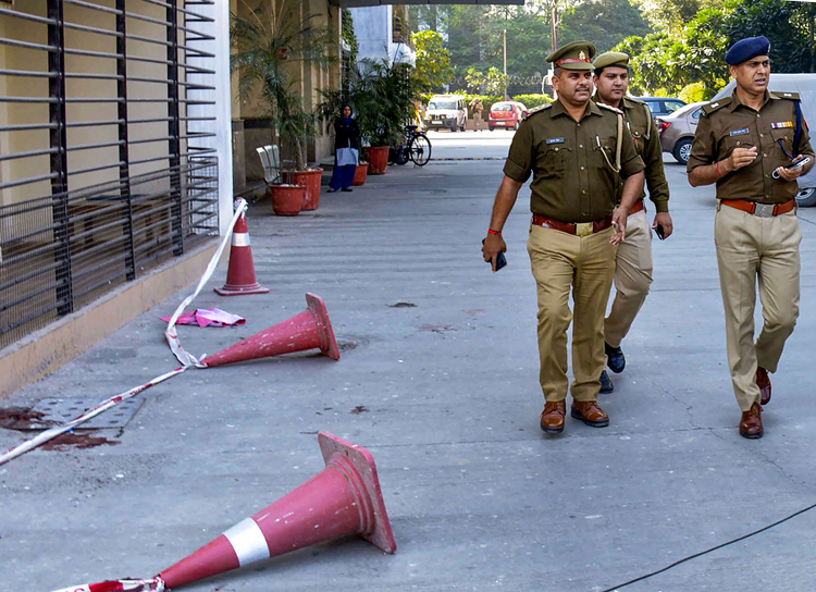 Policemen at the gated apartment complex in Ghaziabad on Tuesday