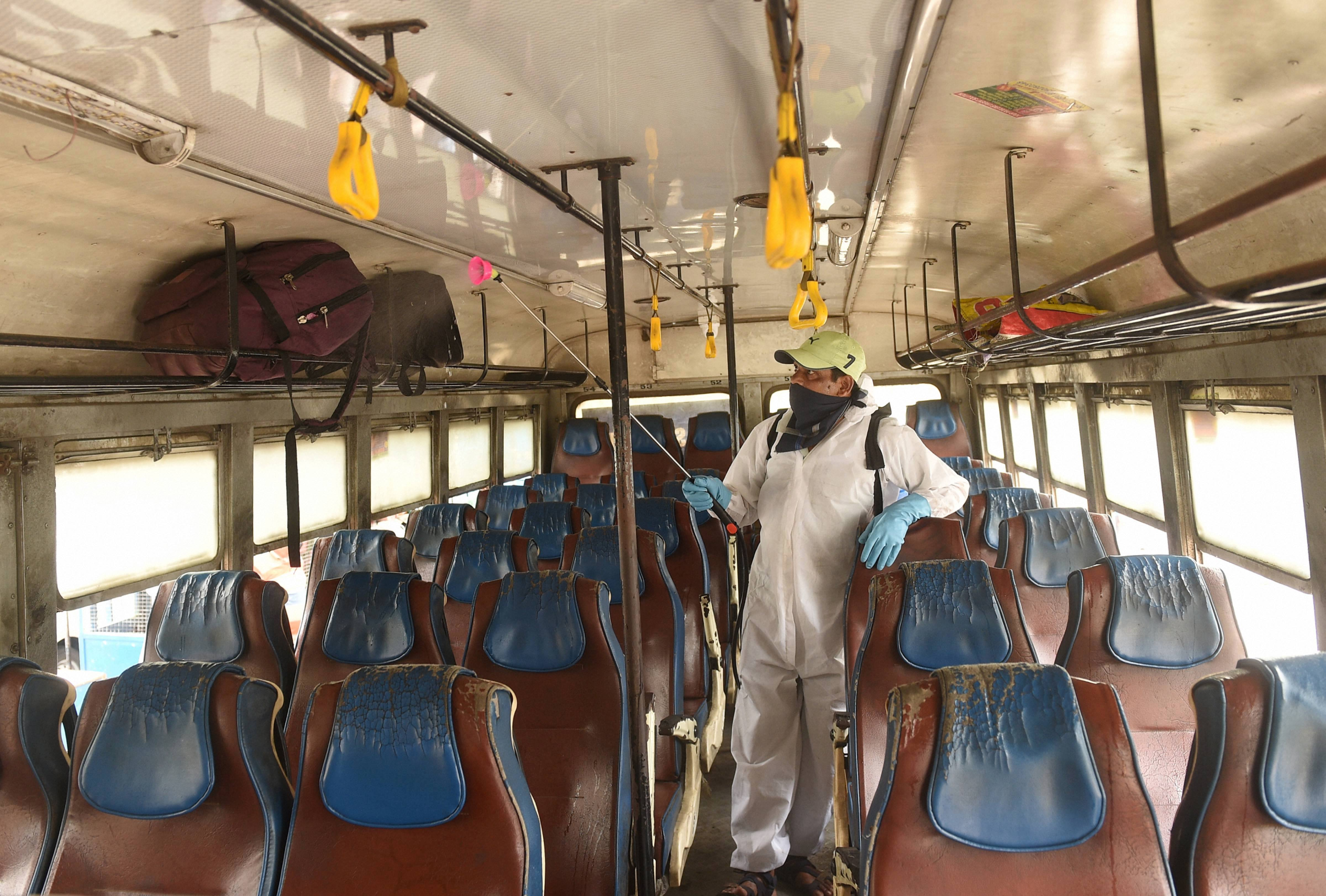 A health worker sanitizes a public bus after the authorities permitted to start the interstate bus service, during the ongoing Covid-19 nationwide lockdown, in Calcutta, Wednesday, May 27, 2020.