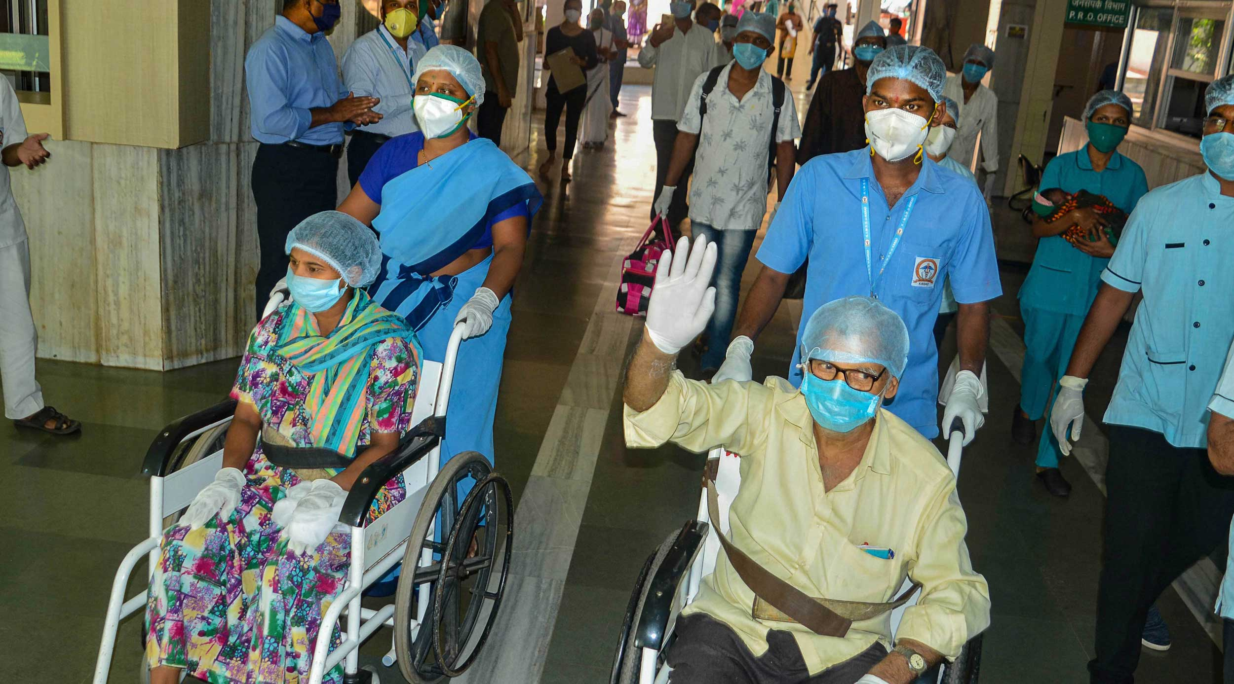 Medics and hospital staff applaud as patients who recovered from Covid-19 prepare to leave a hospital in Karad on Wednesday.