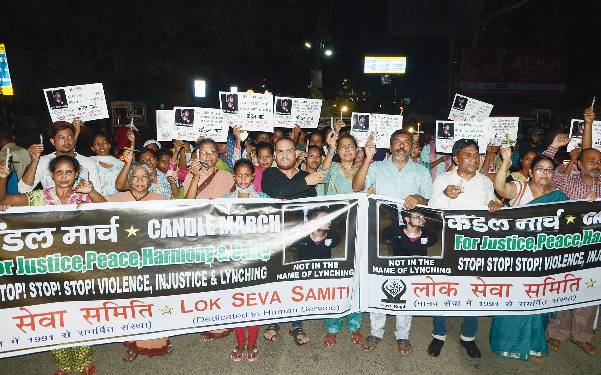 Lok Seva Samiti members take out a candle march at Kutchery Chowk in Ranchi to protest the lynching.