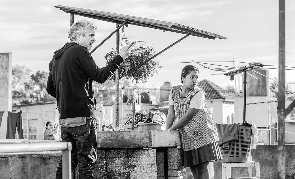 Alfonso Cuaron and Yalitza Aparicio behind the scenes of Roma